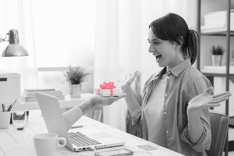 woman receiving gift from computer