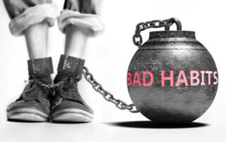 Bad habit ball and chain on someone's foot.