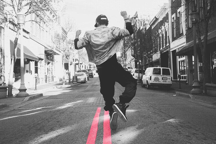 Man jumping in mid street