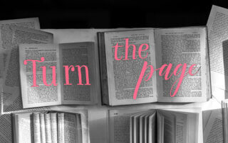 "Quote over opened books ""Turn the page"""