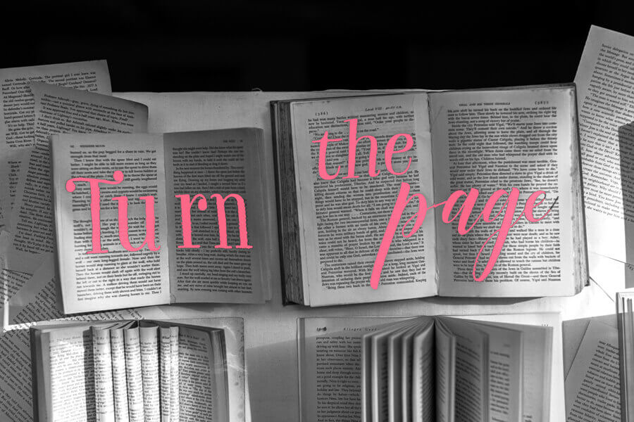 """Quote over opened books """"Turn the page"""""""
