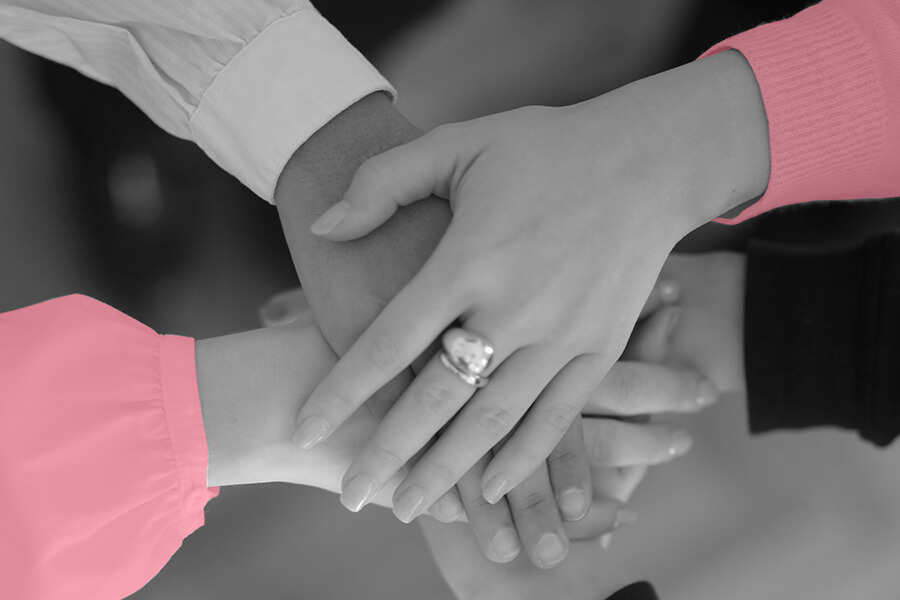 Women stacking hands together