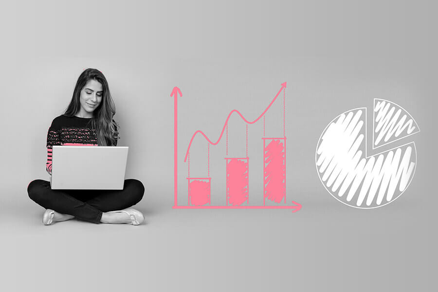 Business Woman on Laptop next to Analytics Charts