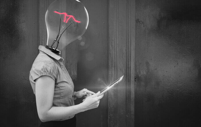 women with a lightbulb for a head, holding a tablet
